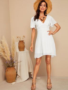Платье с бантом открытой спиной и асимметричным низом