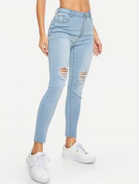 Рваные обтягивающие джинсы с отделкой