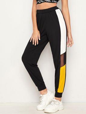 Контрастные спортивные брюки с сетчатыми вставками