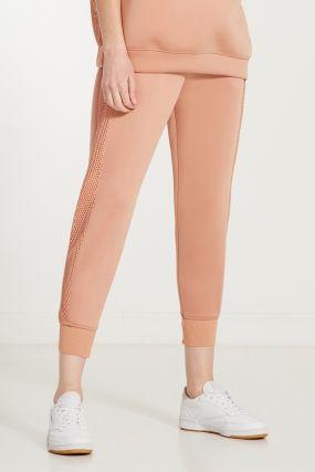 Розовые брюки с сетчатыми вставками