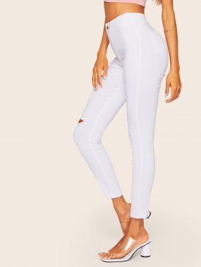 Рваные обтягивающие джинсы с пуговицей