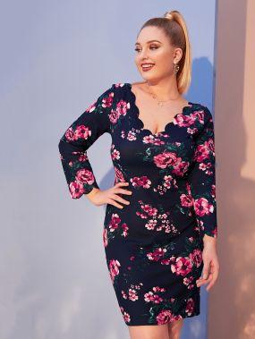 Приталенное платье с цветочным принтом и оригинальной отделкой размера плюс