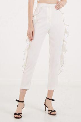 Белые брюки с воланами